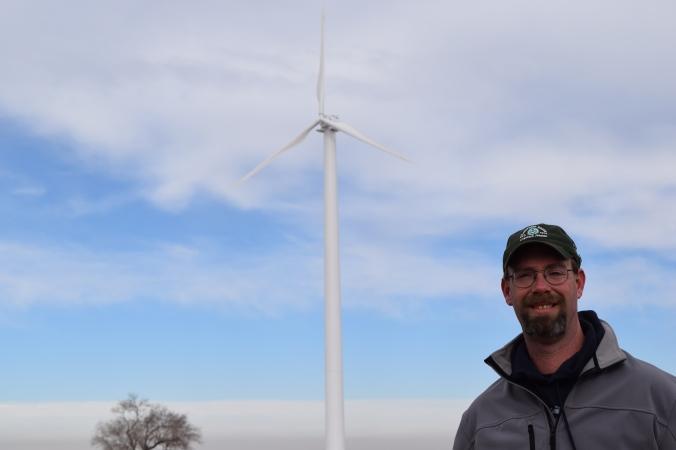 united-wind-justin-niccoli-and-wind-turbine